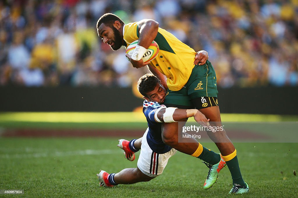 Tevita Kuridrani of the Wallabies is tackled by Wesley Fofana of France during the International Test match between the Australian Wallabies and France at Allianz Stadium on June 21, 2014 in Sydney, Australia.
