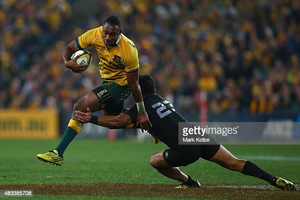 Tevita Kuridrani of the Wallabies jumps to evade the tackle of Malakai Fekitoa of the All Blacks during The Rugby Championship match between the...