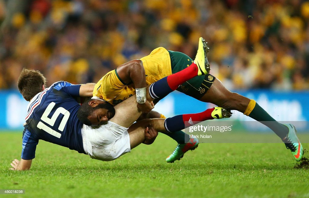 <a gi-track='captionPersonalityLinkClicked' href=/galleries/search?phrase=Tevita+Kuridrani&family=editorial&specificpeople=7612194 ng-click='$event.stopPropagation()'>Tevita Kuridrani</a> of the Wallabies tackles Hugo Bonneval of France during the First International Test Match between the Australian Wallabies and France at Suncorp Stadium on June 7, 2014 in Brisbane, Australia.