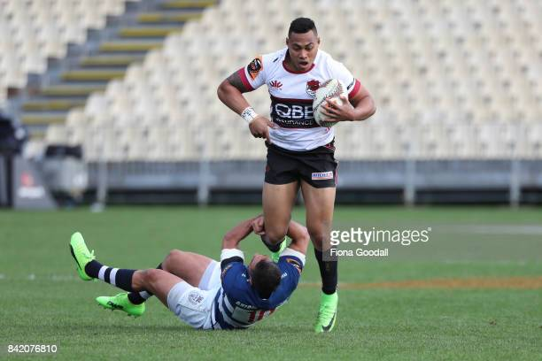 Tevita Li of North Harbour is tackled by Daniel Bowden of Auckland during the round three Mitre 10 Cup match between North Harbour and Auckland on...