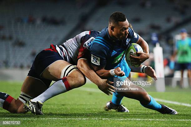 Tevita Li of the Blues dives over to score a try during the Super Rugby round ten match between the Blues and the Melbourne Rebels at Eden Park on...