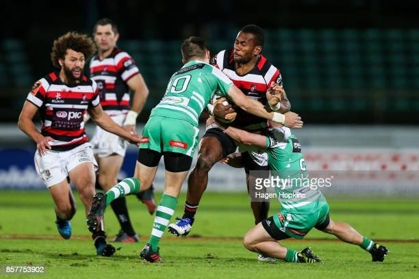 Tevita Nabura of Counties Manukau is tackled by Otere Black and Kayne Hammington of Manawatu during the round eight Mitre 10 Cup match between...