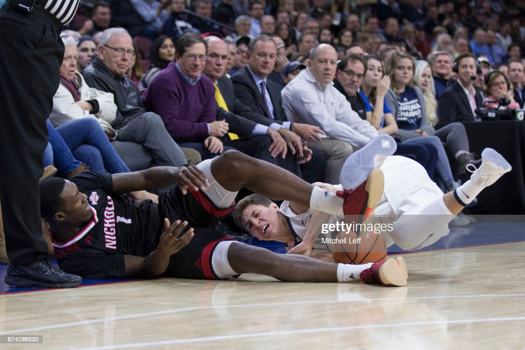Tevon Saddler #1 of the Nicholls State Colonels dives for the ball along with Collin Gillespie #2 of the Villanova Wildcats in the first half at the Wells Fargo Center on November 14, 2017 in Philadelphia, Pennsylvania. The Villanova Wildcats defeated the Nicholls State Colonels 113-77.