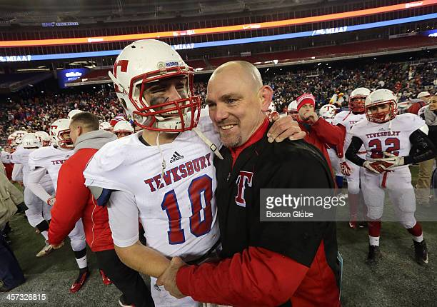 Tewksbury quarterback free safety Johnny Aylward celebrates the win with his father Tewksbury head coach Brian Aylward Tewksbury takes on Plymouth...