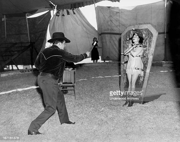Tex and Alice Orton practicing their knife throwing exhibition Venice California 1945