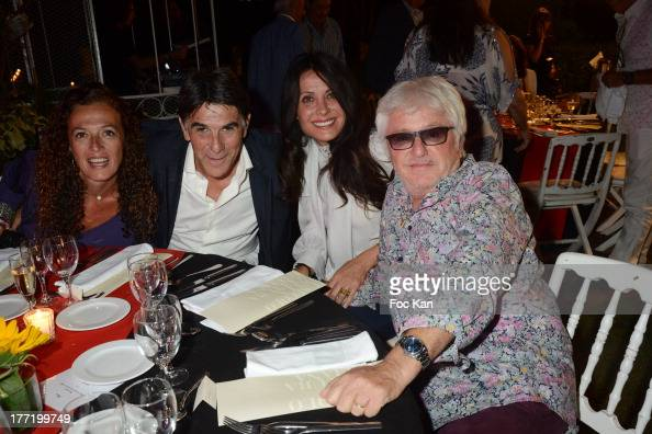 Tex his wife Marc Cerrone and Jill Cerrone attend the Massimo Gargia's Birthday Dinner at Moulins de Ramatuelle on August 21 2013 in Saint Tropez...
