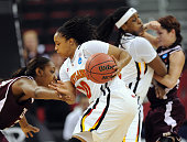 Texas AampM Aggies center Karla Gilbert left reaches in and tries to stop Maryland Terrapins guard Anjale Barrett as Barrett drives towards the...