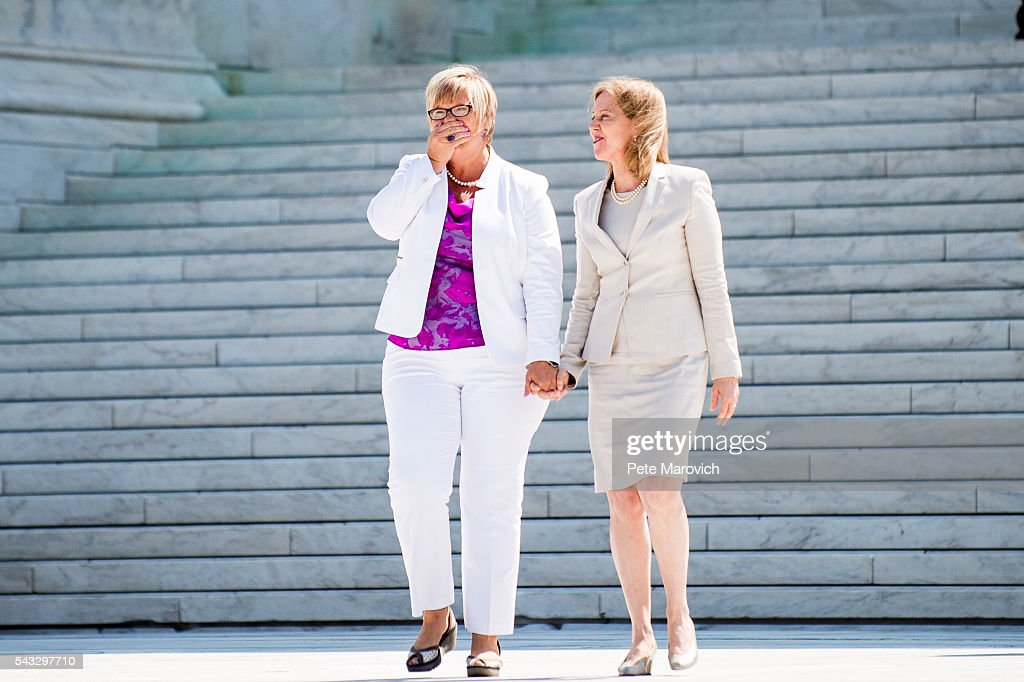 Texas abortion provider Amy Hagstrom-Miller is overcome from the applause as she walks down the steps of the United States Supreme Court with Nancy Northup, President of The Center for Reproductive Rights on June 27, 2016 in Washington, DC. In a 5-3 decision, the U.S. Supreme Court struck down one of the nation's toughest restrictions on abortion, a Texas law that women's groups said would have forced more than three-quarters of the state's clinics to close.
