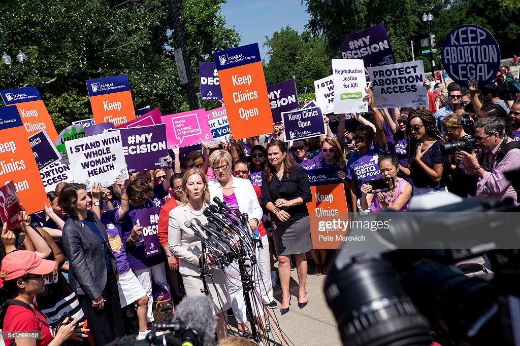 Texas abortion provider Amy Hagstrom-Miller looks on as Nancy Northup, President of The Center for Reproductive Rights speaks to the media outside of the U.S. Supreme Court on June 27, 2016 in Washington, DC. In a 5-3 decision, the U.S. Supreme Court struck down one of the nation's toughest restrictions on abortion, a Texas law that women's groups said would have forced more than three-quarters of the state's clinics to close.