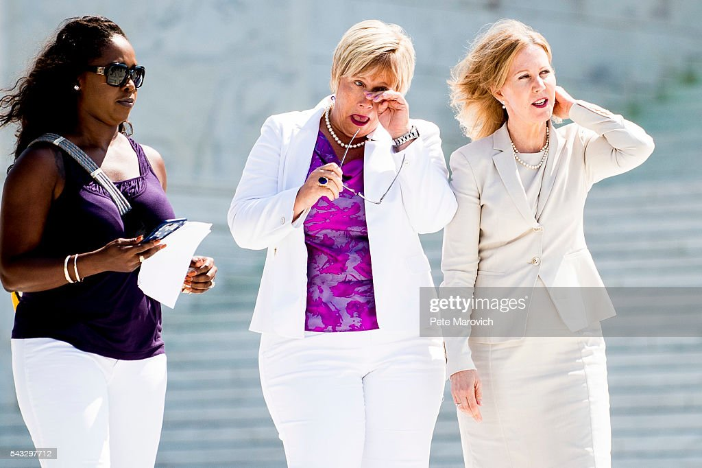 Texas abortion provider Amy Hagstrom-Miller wipes a tear as she walks down the steps of the United States Supreme Court with Nancy Northup, President of The Center for Reproductive Rights on June 27, 2016 in Washington, DC. In a 5-3 decision, the U.S. Supreme Court struck down one of the nation's toughest restrictions on abortion, a Texas law that women's groups said would have forced more than three-quarters of the state's clinics to close.