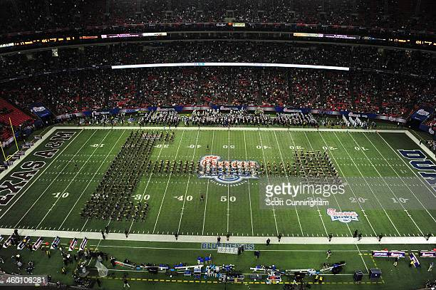 Texas AM Aggies Band performs during halftime of the ChickFilA Bowl against the Duke Blue Devils at the Georgia Dome on December 31 2013 in Atlanta...