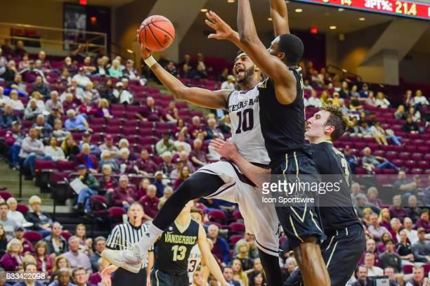 Texas AM Aggies center Tonny TrochaMorelos drives hard to the basket as he's held by Vanderbilt Commodores forward Luke Kornet during the SEC Men's...