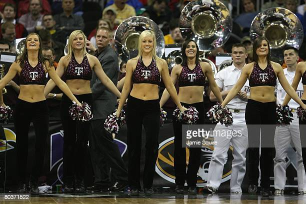 Texas AM Aggies cheerleaders perform during the game against the Iowa State Cyclones during day 1 of the Big 12 Men's Basketball Tournament on March...