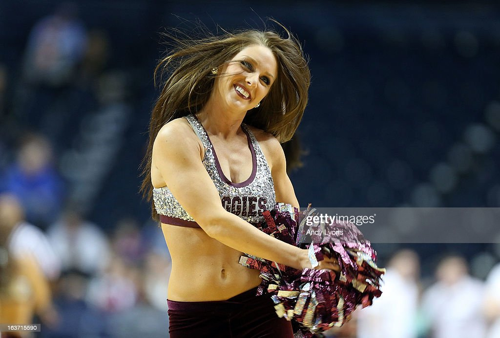 Texas A&M Aggies dance team members perform during the game against the Missouri Tigers in the second round of the SEC Basketball Tournament at Bridgestone Arena on March 14, 2013 in Nashville, Tennessee.