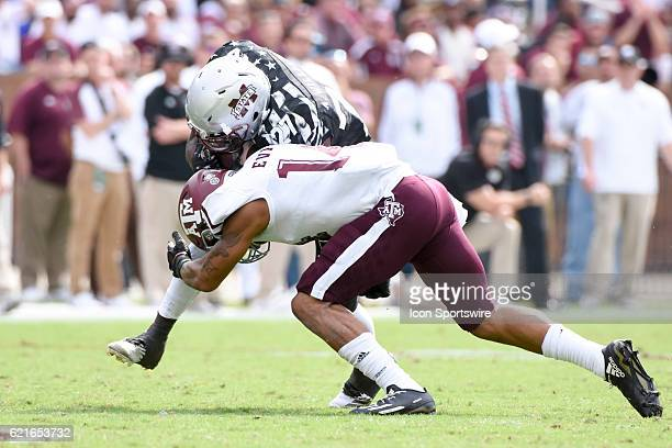 Texas AM Aggies defensive back Justin Evans attempts to tackle Mississippi State Bulldogs running back Aeris Williams during the football game...
