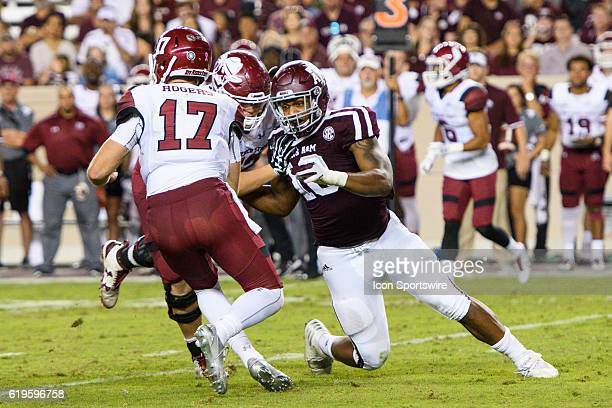 Texas AM Aggies defensive lineman Daeshon Hall closes in on New Mexico State Aggies quarterback Tyler Rogers during the New Mexico State Aggies vs...