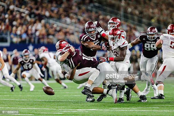 Texas AM Aggies defensive lineman Daeshon Hall hits Arkansas Razorbacks quarterback Austin Allen causing a fumble during the Southwest Classic...