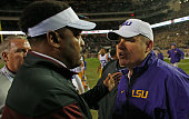 Texas AM Aggies head coach Kevin Sumlin greets head coach Les Miles of the LSU Tigers on the field after the Tigers won 2317 at Kyle Field on...