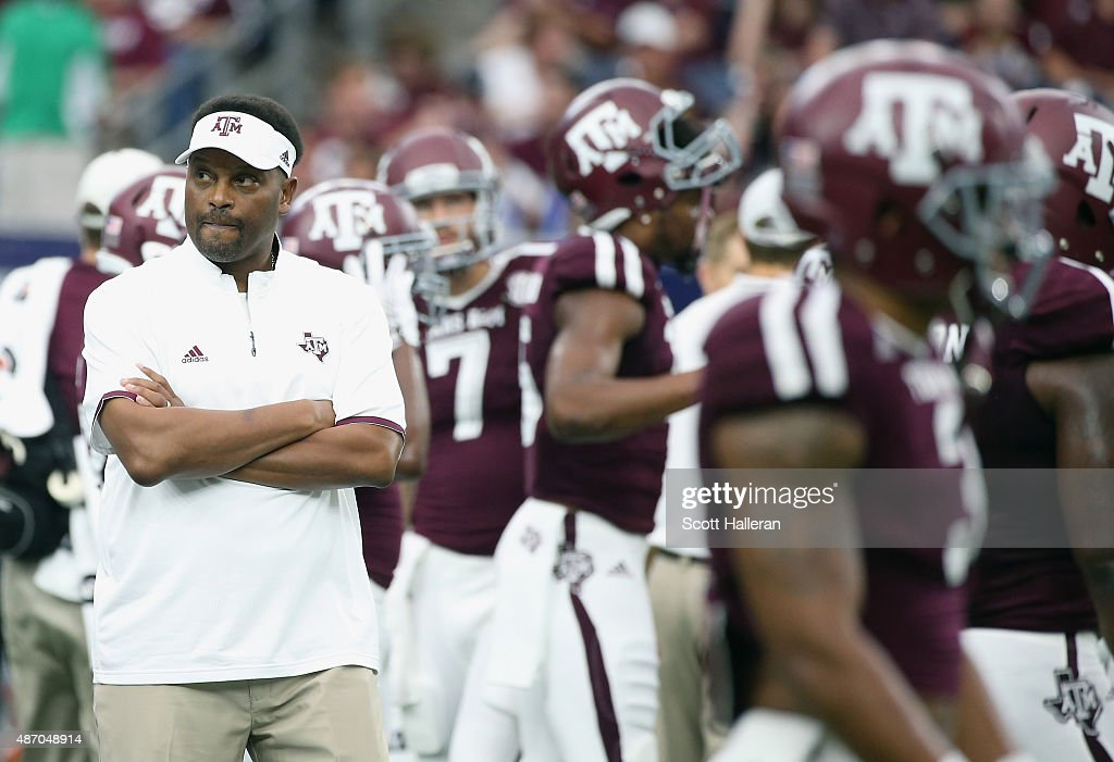 Texas A&M Aggies head coach <a gi-track='captionPersonalityLinkClicked' href=/galleries/search?phrase=Kevin+Sumlin&family=editorial&specificpeople=4819265 ng-click='$event.stopPropagation()'>Kevin Sumlin</a> watches his team work out on the field before the start of their game against the Arizona State Sun Devils during the Advocare Texas Kickoff at NRG Stadium on September 5, 2015 in Houston, Texas.