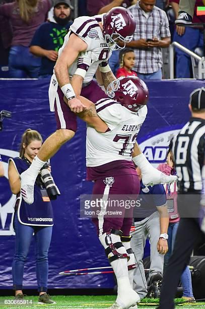 Texas AM Aggies offensive lineman Jermaine Eluemunor hoists Texas AM Aggies quarterback Trevor Knight high after a second half touchdown pass during...