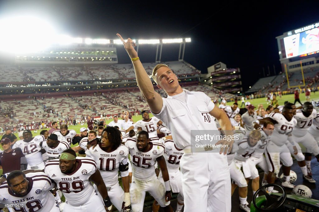Texas A&M Aggies players and fans celebrate after a win over the South Carolina Gamecocks at Williams-Brice Stadium on August 28, 2014 in Columbia, South Carolina. Texas A&M won 52-28.
