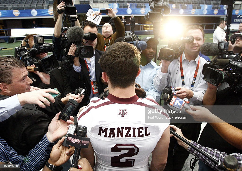 Texas A&M Aggies quarterback Johnny Manziel (2) answers questions from the media during the Cotton Bowl Media Day at Cowboys Stadium Sunday, December 30, 2012.