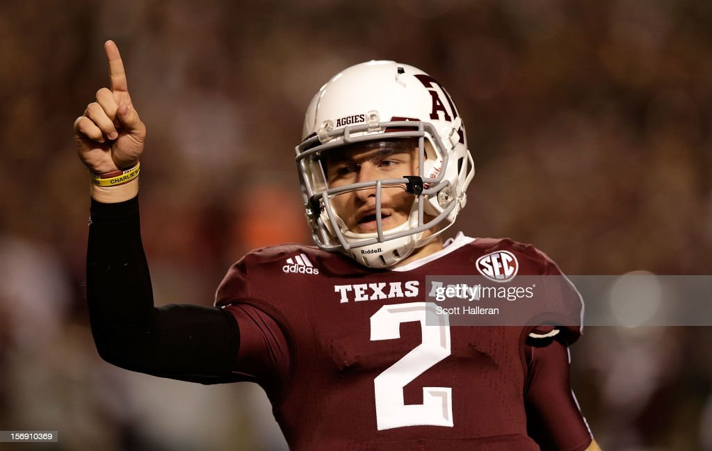 Texas A&M Aggies quarterback <a gi-track='captionPersonalityLinkClicked' href=/galleries/search?phrase=Johnny+Manziel&family=editorial&specificpeople=9703372 ng-click='$event.stopPropagation()'>Johnny Manziel</a> #2 celebrates a first quarter touchdown during their game against the Missouri Tigers at Kyle Field on November 24, 2012 in College Station, Texas.