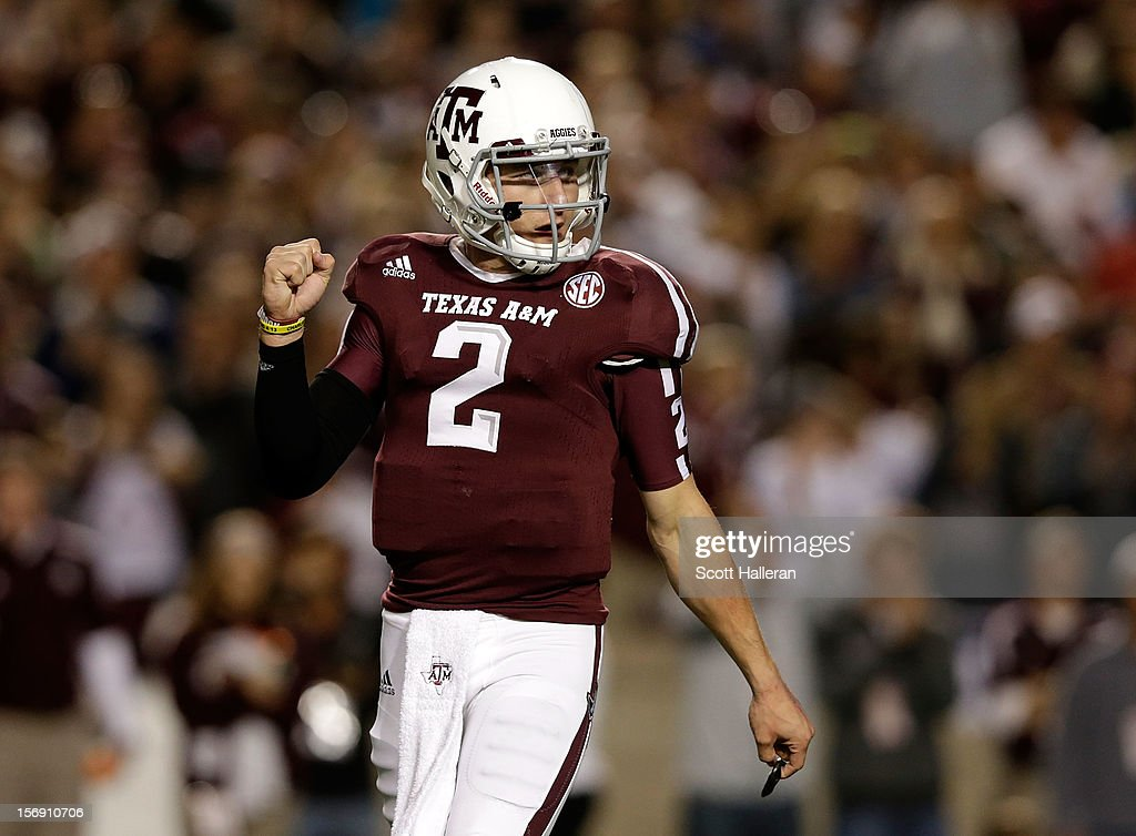 Texas A&M Aggies quarterback Johnny Manziel #2 celebrates a first quarter touchdown during their game against the Missouri Tigers at Kyle Field on November 24, 2012 in College Station, Texas.