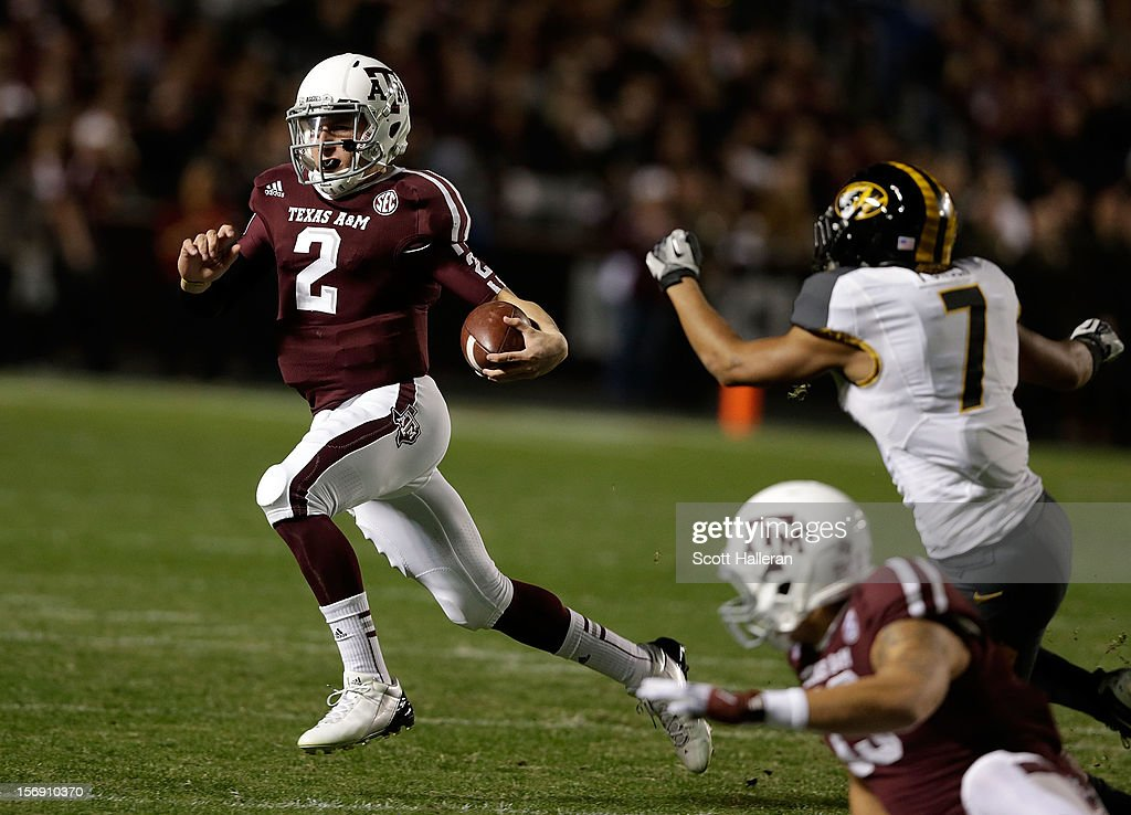 Texas A&M Aggies quarterback <a gi-track='captionPersonalityLinkClicked' href=/galleries/search?phrase=Johnny+Manziel&family=editorial&specificpeople=9703372 ng-click='$event.stopPropagation()'>Johnny Manziel</a> #2 rushes for a gain during their game against the Missouri Tigers at Kyle Field on November 24, 2012 in College Station, Texas.