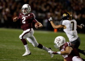 Texas AM Aggies quarterback Johnny Manziel rushes for a gain during their game against the Missouri Tigers at Kyle Field on November 24 2012 in...