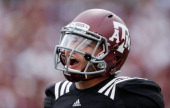 Texas AM Aggies quarterback Johnny Manziel walks to the sideline after a touchdown during the Maroon White spring football game at Kyle Field on...