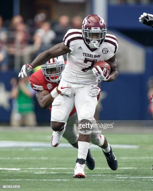 Texas AM Aggies running back Keith Ford tries to break away from the tackle of Arkansas Razorbacks linebacker Randy Ramsey during the college...