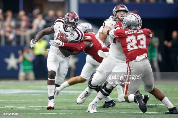 Texas AM Aggies running back Keith Ford tries to break the tackle of Arkansas Razorbacks linebacker Randy Ramsey during the college football game...