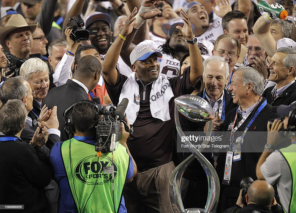 Texas A&M head coach Kevin Sumlin acknowledges the crowd during the trophy presentation after a 41-13 win over Oklahoma in the AT&T Cotton Bowl game in Cowboys Stadium in Arlington, Texas, on Friday, January 4, 2013.