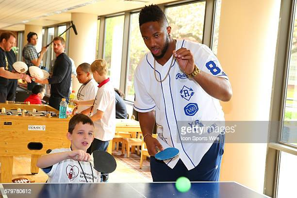 Texas AM Offensive Tackle Cedric Ogbuehi plays ping pong with Drew Beutel at the Shriners Childrens Hospital in Chicago The event brought 19 2015 NFL...