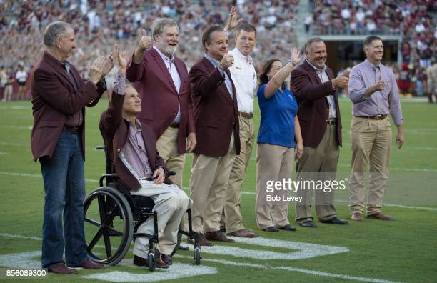 LR_ Texas AM President Michael Yound Governor Greg Abbott Texas AM Regent Charles Schwarts and Texas AM Chancellor John Sharp acknowledge the crowd...