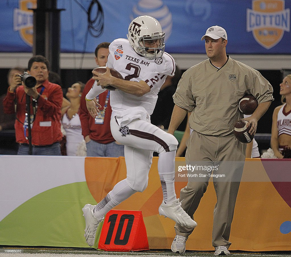 Texas A&M quarterback Johnny Manziel (2) along the sideline during a 23-yard touchdown run in the first quarter against Oklahoma in the AT&T Cotton Bowl game in Cowboys Stadium in Arlington, Texas, on Friday, January 4, 2013.