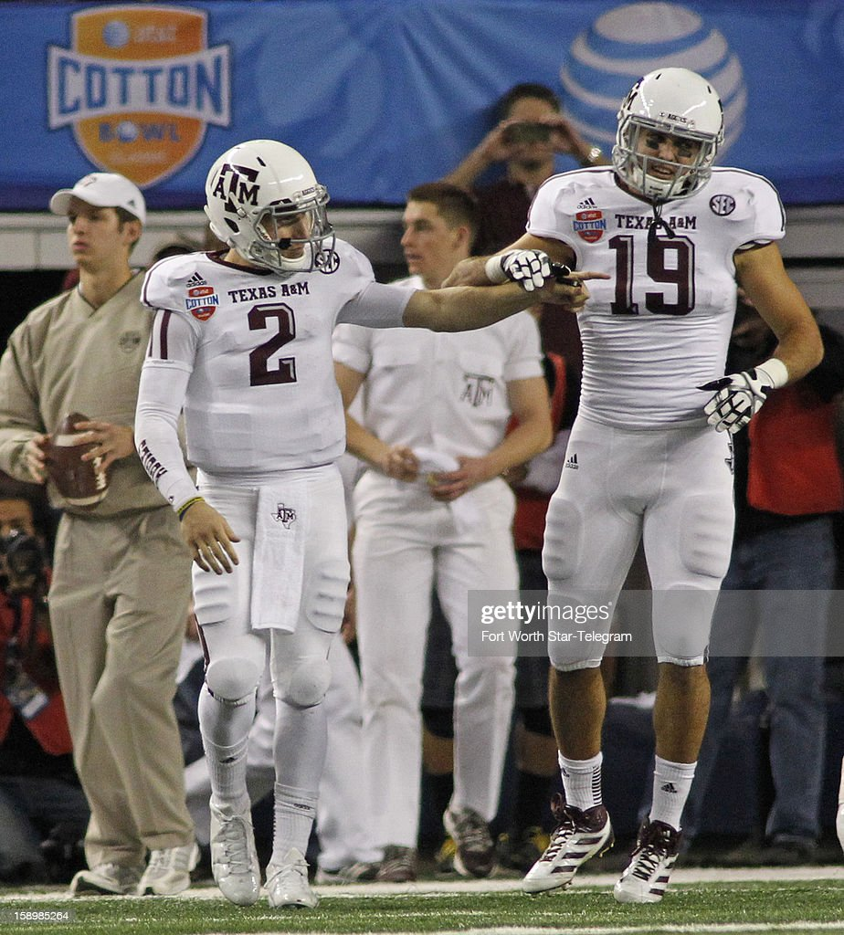 Texas A&M quarterback Johnny Manziel (2) and tight end Michael Lamothe (19) celebrate after Manziel's 5-yard touchdown run in the second quarter against Oklahoma in the AT&T Cotton Bowl game in Cowboys Stadium in Arlington, Texas, on Friday, January 4, 2013.