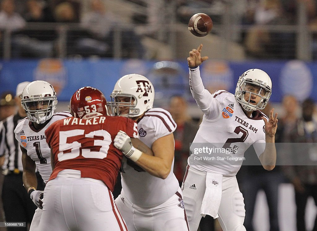 Texas A&M quarterback Johnny Manziel (2) passes in the third quarter against Oklahoma in the AT&T Cotton Bowl game in Cowboys Stadium in Arlington, Texas, on Friday, January 4, 2013. Texas A&M dispatched the Sooners, 41-13, as Manziel threw two TD passes and ran for two more.
