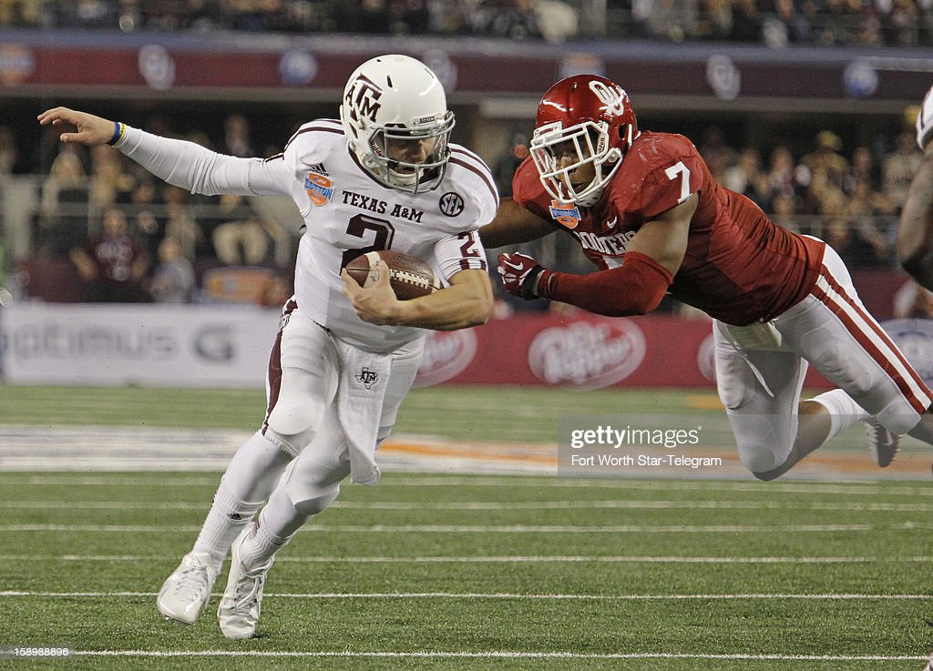 Texas A&M quarterback Johnny Manziel scrambles away from Oklahoma linebacker Corey Nelson (7) in the third quarter in the AT&T Cotton Bowl game in Cowboys Stadium in Arlington, Texas, on Friday, January 4, 2013. Texas A&M dispatched the Sooners, 41-13.
