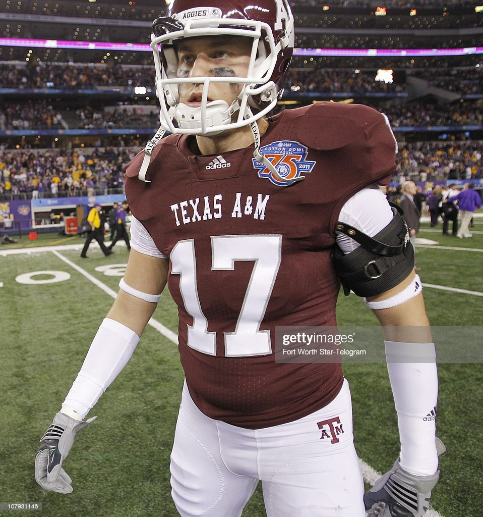 Texas A&M quarterback Ryan Tannehill (17) leaves the field after a 41-24 loss to Louisiana State in the Cotton Bowl at Cowboys Stadium in Fort Worth, Texas, on Friday, January 7, 2011.