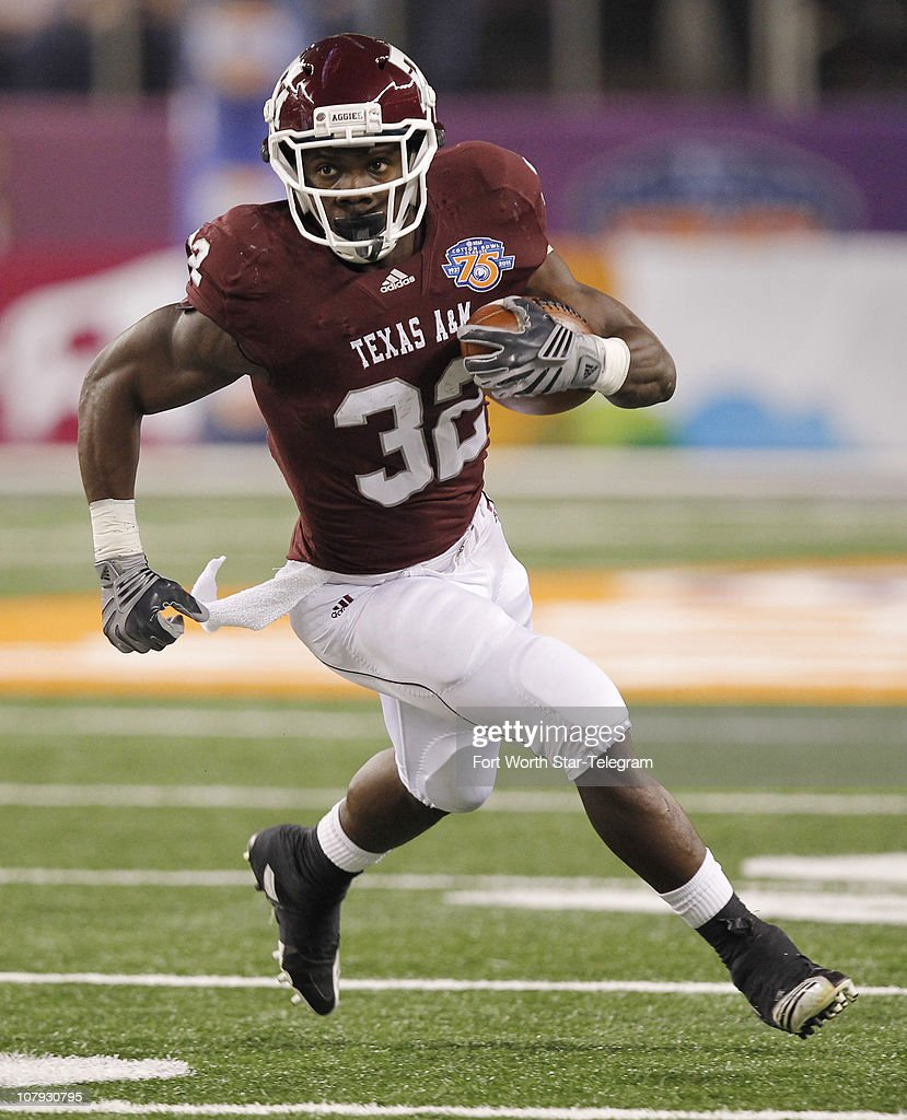 Texas A&M running back Cyrus Gray carries the ball for 18 yards and a first down in the first quarter against Louisiana State in the Cotton Bowl at Cowboys Stadium in Fort Worth, Texas, on Friday, January 7, 2011.