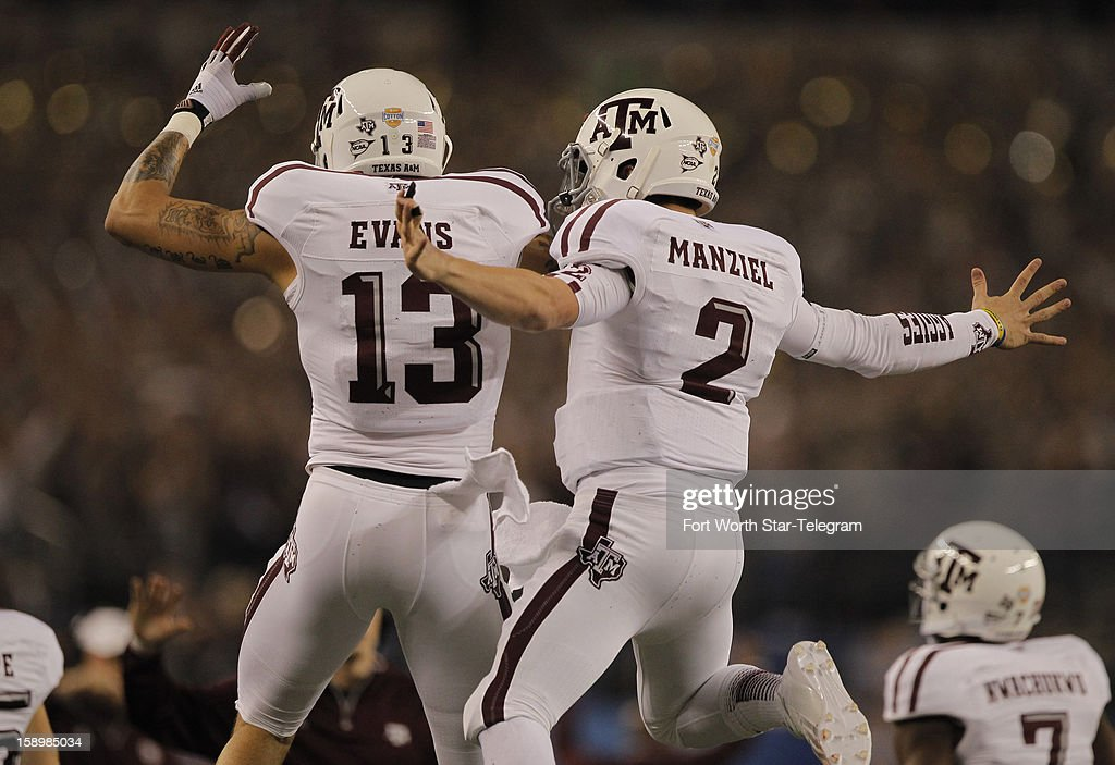 Texas A&M wide receiver Mike Evans (13) and quarterback Johnny Manziel (2) celebrate after Manziel's 23-yard touchdown run in the first quarter against Oklahoma in the AT&T Cotton Bowl game in Cowboys Stadium in Arlington, Texas, on Friday, January 4, 2013.