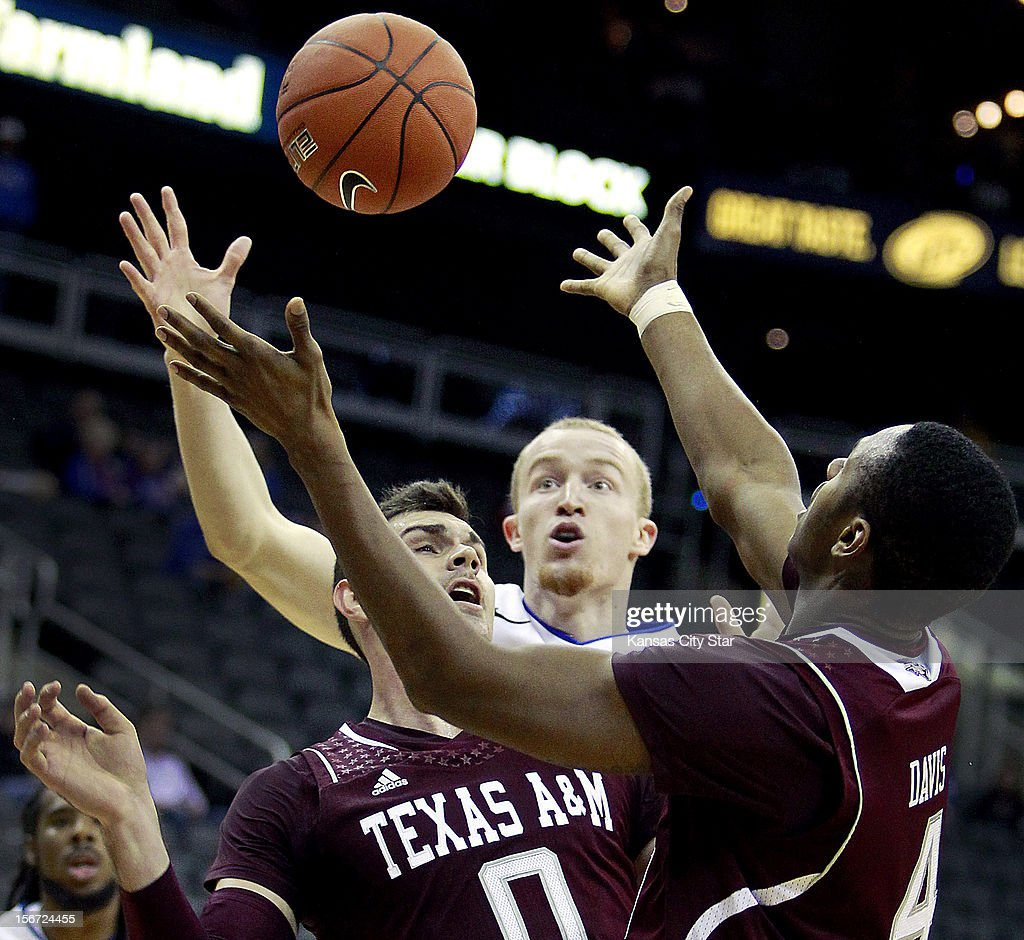 Texas A&M's Andrew Young (0) and teammate Keith Davis (4) battle for a rebound with St. Louis's John Manning during the first half of the CBE Hall of Fame Classic in Kansas City, Missouri on Monday, November 19, 2012.
