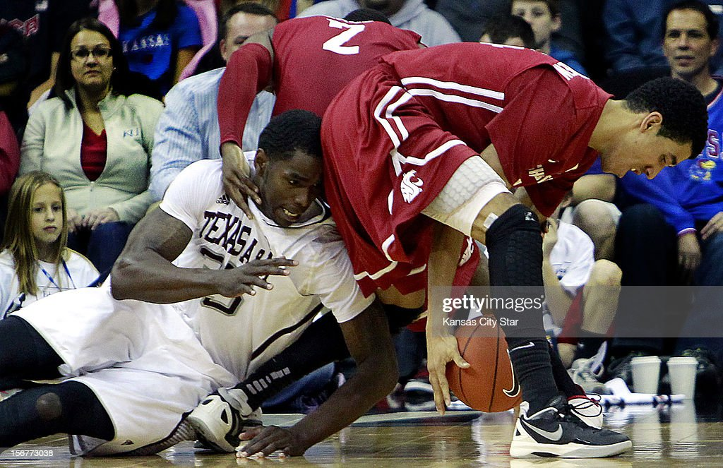 Texas A&M's Ray Turner, left, goes to the floor while battling Washington State's Dexter Kernich-Drew for the ball during the second half of the consolation game of the CBE Hall of Fame Classic at the Sprint Center in Kansas City, Missouri, on Tuesday, November 20, 2012.
