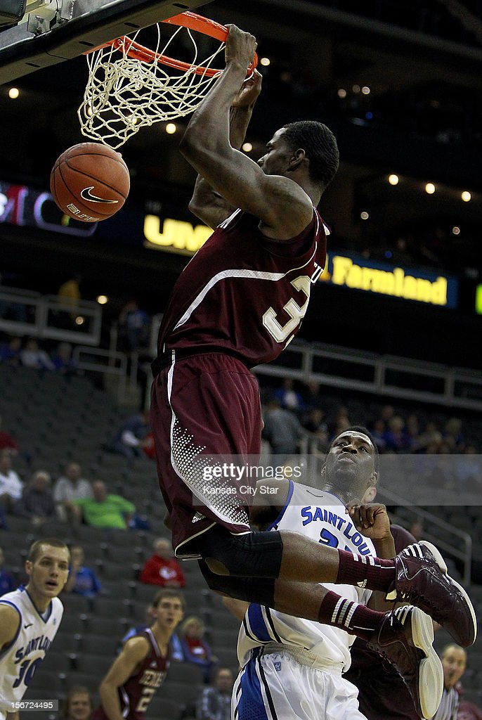 Texas A&M's Ray Turner puts down a two hander over Saint Louis' Cory Remekun during the first half of the CBE Hall of Fame Classic in Kansas City, Missouri on Monday, November 19, 2012.