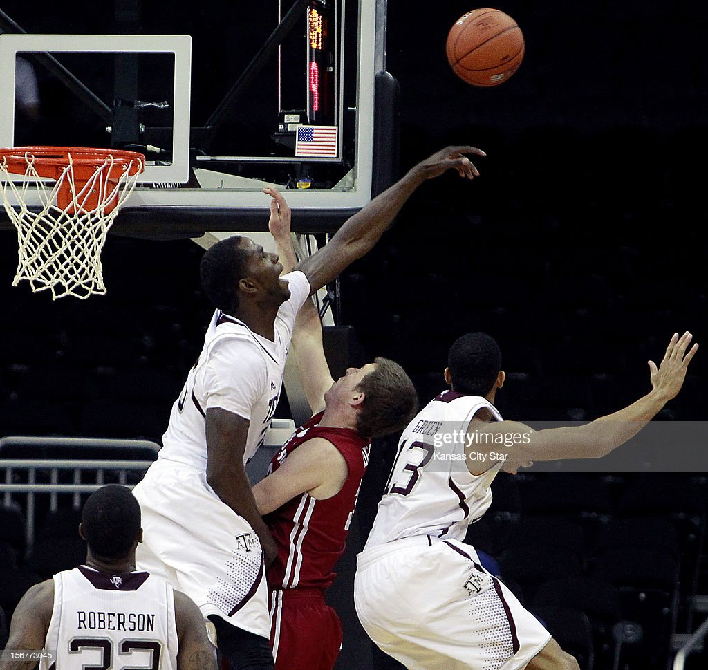 Texas A&M's Ray Turner, top left, swats a shot taken by Washington State's Brett Boese during the first half of the consolation game of the CBE Hall of Fame Classic at the Sprint Center in Kansas City, Missouri, on Tuesday, November 20, 2012.