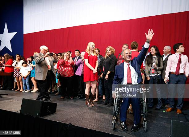 Texas Attorney General and Republican gubernatorial candidate Greg Abbott celebrates during his victory party on November 4 2014 in Austin Texas...