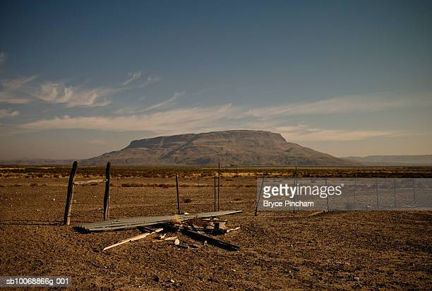 USA, Texas, Big Bend, Fence with broken wood, mountain in background