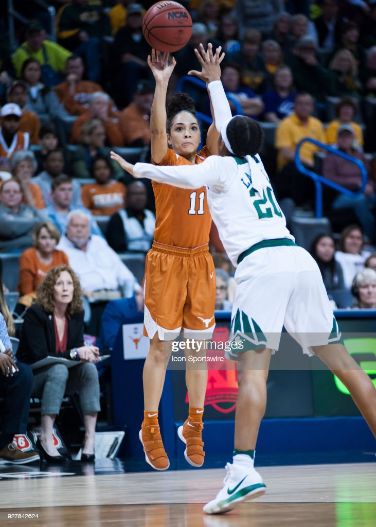 Texas (11) Brooke McCarty shooting a there pointer while Baylor (20) plays defense during the Big 12 Women's Championship on March 05, 2018 at Chesapeake Energy Arena in Oklahoma City, OK.